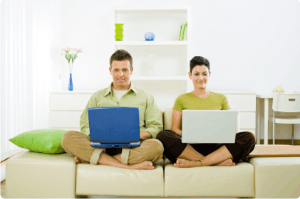 Couple working on sofa
